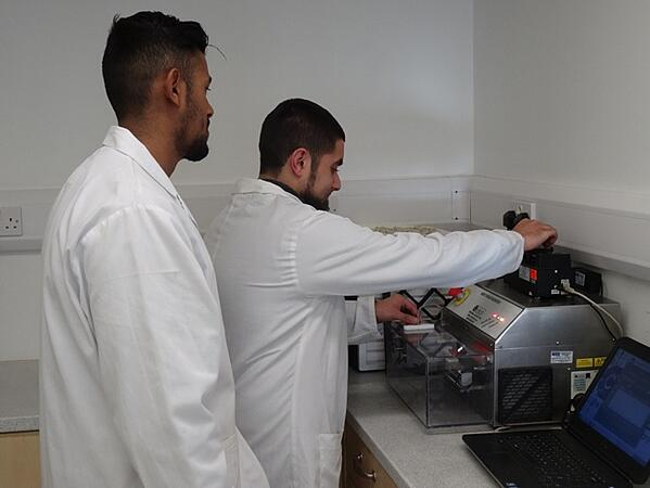 Akhil and Mohammed working with the Mixer Torque Rheometer in the Caleva laboratory