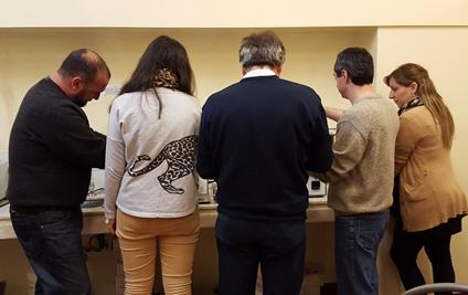 The picture shows the high interest in the Caleva Extruder and Spheronizer during the training on the customer site