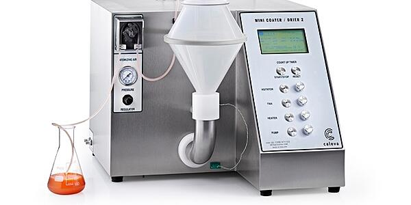 The laboratory mini coater drier for use with tablets and pellets